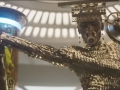 star_wars_solo_super_bowl_trailer_performer_in_gold_with_mic_and_mouthpiece_and_creature_in_glass_jar