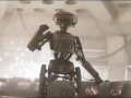 star_wars_solo_trailer_droid_in_front_of_monitor_screens_2